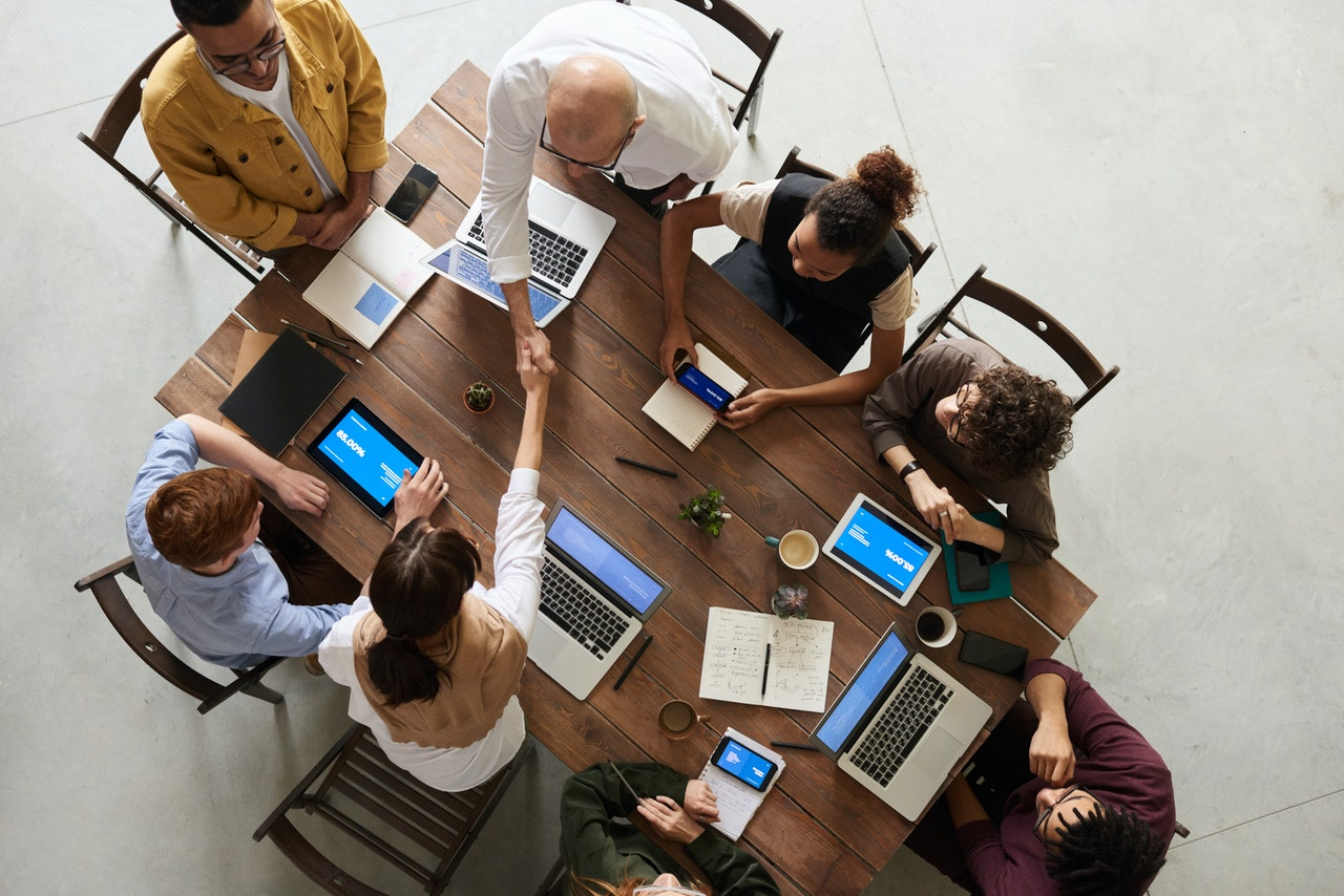 people in meeting improving performance at work